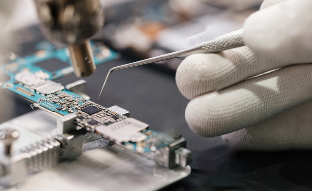 stock-photo-work-with-a-soldering-iron-microelectronics-device-close-up-hands-of-a-service-worker-repairing-1089303941