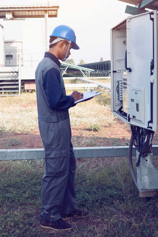 Workers who install and test transformerless inverters